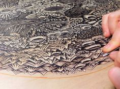 Since 2006 Pittsburgh-based husband and wife Paul Roden and Valerie Lueth have run the Tugboat Printshop, a traditional printmaking studio where everything is made by hand, starting with the giant slabs of wood into which each of their images are carved. The Moon is their largest hand-carved relief print ever coming in at 36″ x 32″ (91 x 82 cm) and will printed using two colors.
