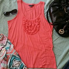 NWOT! Banana Republic Salmon Tank! So soft! So flowy! It fits like a med. But marked as a Large. Such a beautiful salmon color. It photographed just a smidge brighter then it is. 86% Rayon 9% Silk 5% Spandex Banana Republic Tops Tank Tops
