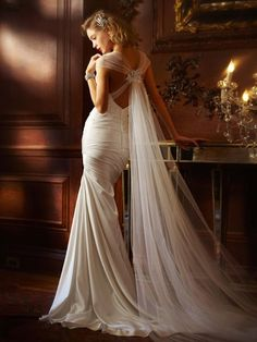 Elegant wedding dress - Love how the vail hangs from the x in the back