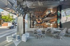 Daewha Kang uses mirrored stainless steel to transform Communique HQ - Retailand Office Design Outdoor Cafe, Outdoor Restaurant, Cladding Design, Column Design, Retail Interior, Bridge Design, Design Blog, Facade Architecture, Commercial Design