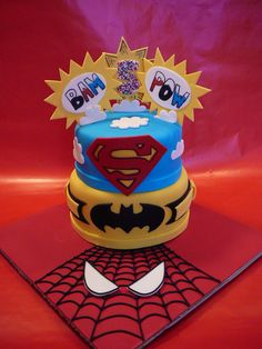 I had a request for a Super Heros cake and that is what I designed, inspired by so many cakes I saw here on Cake Central. This cake was marble with chocolate ganache covered with fondant. All details are fondant. The spiders web is piped royal icing.