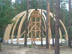The domed building with the use of bent laminated wood structures.