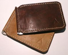 This handmade leather money clip style wallet has 2 individual credit cards slots. You can even put a few more cards in the same slots. Up to 8 cards total. Cash is snapped down by the clip in the middle. Pick your leather colour from the list, then pick your stitching colour from the list. All hand made with premium leather hides and hand saddle stitched. Classic quality leather style.