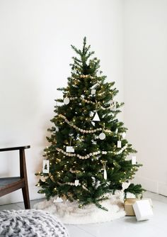 50 Christmas trees fully decorated from top to bottom featuring a variety of Christmas themes.