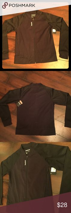 NWT REEBOK Reebok stretchy black bomber workout jacket with textured sleeves and zip up front. Make me an offer! Then check out the rest of my closet for more cool stuff! Bundle to get a stellar discount! Reebok Tops Sweatshirts & Hoodies