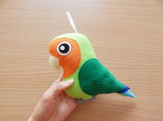 ☆ Peach-Faced, Orange-Faced, Lutino Peach-Faced Lovebird ornament ☆  ・Lovebird is about 17.5cm/ 6.8 tall (include tail), with a loop for hanging - lovebird and 1 heart. The back of lovebird has just one colour felt (no patterns). ・Made from acrylic (or polyester) felt and stuffed with poly fill. ・Designed and stitched by me.   ・Items are made in a smoke free, pet free environment. ・The item you receive may look slightly different than the pictures because it is handmade product but it mu...