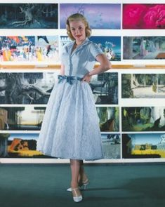 "Mary Costa appears in front of a bank of colorful concept art. Costa voiced Princess Aurora in Disney's 1959 animated classic ""Sleeping Beauty."""