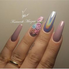 Next nail design, yellow nails, holographic middle finger, and different colored flowers for spring!