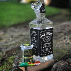 Made this Jack Daniels Bong. Marijuana Art, Cannabis Oil, Liquor Bottle Lights, Liquor Bottles, Liquor Dispenser, Water Bongs, Buy Edibles Online, Diy Crafts To Do, Smoke Weed