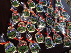 Teenage Mutant Ninja turtle cookies. I had to use an egg shaped cookie cutter then round out the head and form the cheeks and chin by hand.