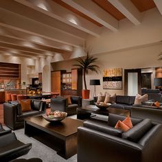 orange & neutral coloured cushions for dark brown leather couch