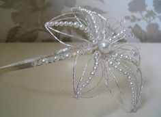 Handmade Swarovski Crystal and Pearl Exotic Lily Side Tiara; £80.00; Free UK Delivery; http://www.bellachoice.com/2013-cheap-uk-bridal-dresses-veils-bags-shoes-gloves-jewellery-and-tiaras-and-hair-accessories/2013-cheap-uk-bridal-and-wedding-tiaras-bands-and-hair-accessories-with-free-uk-delivery/lily-side-tiara.html