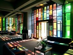 "Stained glass in the Ethical Society of St. Louis (in Ladue, MO) -- ""Light streaming into the main entry hall shines through the abstract, yet sensual colors of the stained glass [Harris] Armstrong selected for this south-facing space."