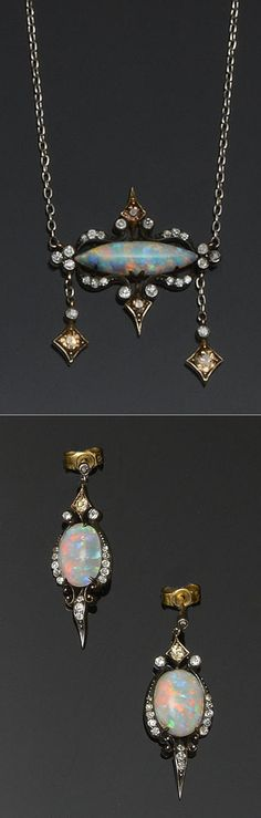 I love the whimsical ~ fairy look of this piece. An opal and diamond necklace and earpendants suite Of scrolling cartouche design, the pendant set with a navette-shaped cabochon opal, to diamond set border and pendant drops set with graduated old-cut diamonds of white and brown tint, on a fine trace-link back chain stamped '9c'.