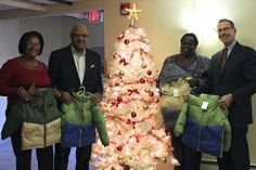 Craig Williams of Santander Bank presented 25 coats to the children at Family House Norristown. Here, Craig poses with Family House administrative assistant Arveinell Keys, director Avis Sawyer-Gordon, and RHD development director Steven Evans at Family House Norristown.