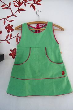 insp use plain jumper pattern & add pocket & piping. like the key hole tie back option instead of zip too. Little Girl Outfits, Little Girl Fashion, Little Girl Dresses, Kids Outfits, Sewing Kids Clothes, Sewing For Kids, Baby Sewing, Jumper Patterns, Baby Dress Patterns