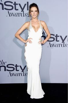 Alessandra Ambrosio wears an Alexandre Vauthier Haute Couture white silk gown with cut-outs and crystal detailing.