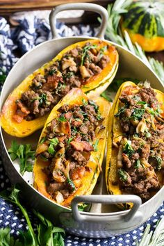 Delicata squash is roasted to perfection and stuffed with ground beef, caramelized onions, bacon, spinach, mushrooms and seasonings. This cozy paleo and Whole30 stuffed squash is great for any meal or as a side dish. Savory, filling and healthy!