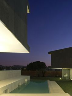This house in Barcelona by architect Santiago Parramón of RTA-Office is clad in slabs of basalt.