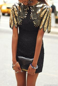 Black  sequined mini cocktail dress ( with gold leaf inspired cap sleeve )
