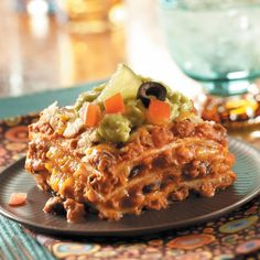 Favorite Mexican Lasagna Recipe -Tortillas replace lasagna noodles in this beefy casserole with a south-of-the-border twist. With salsa, enchilada sauce, chilies, cheese and refried beans, it's a fiesta of flavors. —Tina Newhauser, Peterborough, New Hampshire