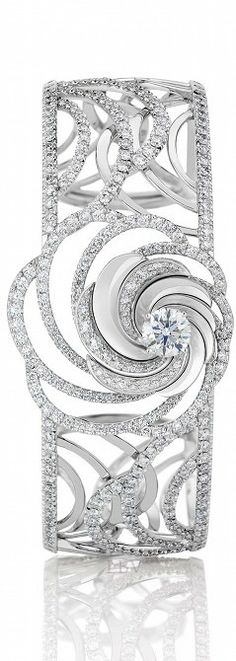 De Beers Aria diamond bracelet, with a series of swirling white gold ribbons set with pavé diamonds surrounding a central brilliant-cut diamond. Diamond Bracelets, Diamond Jewelry, Bangle Bracelets, Necklaces, High Jewelry, Jewelry Accessories, Jewelry Design, Saphir Rose, Diamond Are A Girls Best Friend