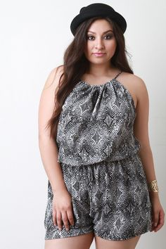 This chic plus size romper features a lightweight woven fabrication, adjustable self tie spaghetti straps, back keyhole, elastic waist, faux drawstring, and a loose fit short. Accessories sold separately. Made in U.S.A. 98% Polyester, 2% Spandex.