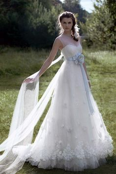 This is my absolute dream dress.  Minus the dangley fabric in the back and the giant bow.  But the top is exactly what I want and the bottom is the perfect balance of poofy and flowy! I just love this!