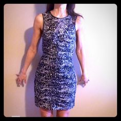 H&M BLACK AND WHITE DRESS Beautiful  new without tags's black and white sleeveless dress! Zipper in the back scrunched up in the front- size :4 H&M Dresses Mini