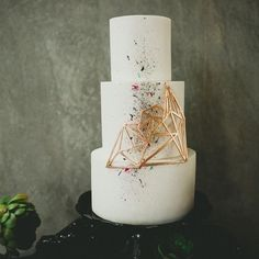 Modern #weddingcake idea - three-tier wedding cake with three-dimensional accent and paint splatter detail  {Melissa Biador Photography}