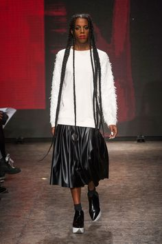 DKNY, Fall 2014, New York. Braids so long you can see her comin'