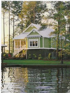 A summer home on the lake with a wonderful screened porch overlooking the water.  This looks so peaceful and inviting!