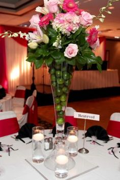 Dallas wedding photographers | wedding reception flower arrangement ideas | wedding reception table decoration | candles and flowers setting | wedding reception in pink colors