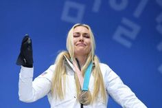 Lindsey Vonn cries on the podium after what was her last appearance in the Olympics. (JAVIER SORIANO... - File photo