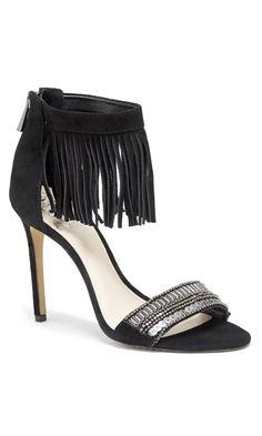 Black, suede fringe heels with metallic beading across the toe strap.