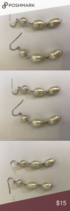 Silver Faux Hanging Pearl Earrings Adorable simple hanging earrings adorned with faux pearls. Silver hooks. Hand beaded. There are a couple very minor dents in a couple of the beads - see pictures. In otherwise perfect condition. These will go perfect with any outfit. Jewelry Earrings
