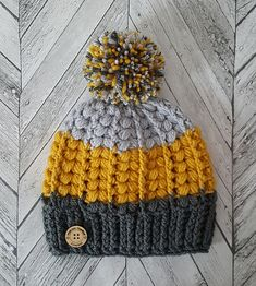The Harris beanie is comprised of the v puff stitch and front post treble crochets. Its a contemporary design with many colour options and looks available.