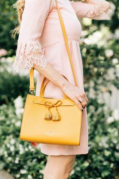 Kate Spade yellow tassel purse