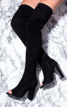 Pull yourself up to towering style heights in these over-the-knee block heeled boots. Pair with some simple black leggings and a satin roll-neck top for cutting-edge class.