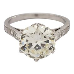 The style features 1 Old European cut diamond, that weighs carats. 2 Old European cut diamonds flank the center stone. Estate Engagement Ring, Diamond Engagement Rings, Art Deco Jewelry, Modern Jewelry, Diamond Rings, Diamond Cuts, Vintage Rings, Vintage Jewelry, European Cut Diamonds
