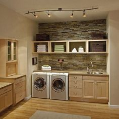 Beautiful laundry room leaves me wondering if I cant have just ONE messy room in the house? Why not the laundry room?) Laundry room - love the stone wall. Laundry Room Storage, Laundry Room Design, Laundry In Bathroom, Small Laundry, Laundry Shelves, Bathroom Plumbing, Laundry Decor, Garage Laundry, Basement Bathroom