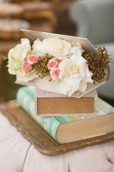 book overflowing with flowers for centerpiece idea - book box from michaels with plastic guard and succulents?