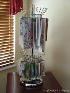 Clip It Up-Shoerack Style using a shoerack, mini-binder clips, & paperclips.