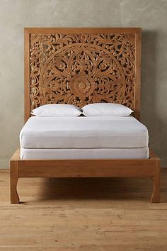 Lombok Bed - Handcarved from solid mango wood, this elegant bed frame is a true work of art. Its filigree-inspired cutouts create a lively shadow play when placed near a sunny window. -  anthropologie.com