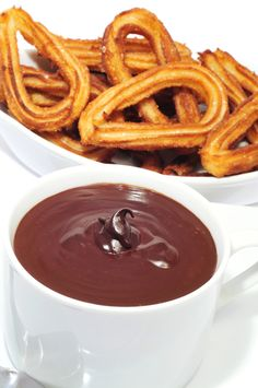 Churros with chocolate. Churros (frutos de sartén) are a typical and traditional Spanish food. It's a Spanish tradition to have them either for breakfast or in the evening with friends.
