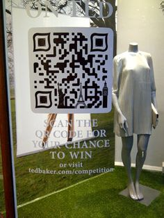 Ted Baker - Window Competition   Interactive windows, nice detail in the QR Tag here, but a little obvious as the BIG QR code is plonked in the window !