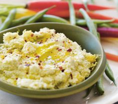 Combine tangy cheese, lemon, garlic and olive oil to create a simple and crowd-pleasing condiment.