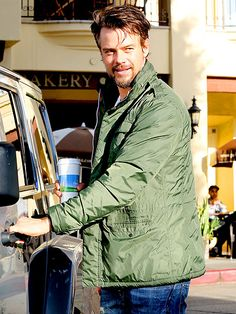 DOOR MAN | Josh Duhamel soaks up a little sunshine before hopping in his car during a coffee run Thursday in Brentwood, Calif.