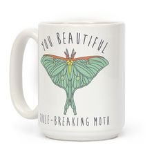 """Remind yourself every morning that you are a beautiful graceful moth that can't be tamed. This funny coffee mug features an illustration of a lunar moth and the phrase """"You Beautiful Rule Breaking Moth."""""""