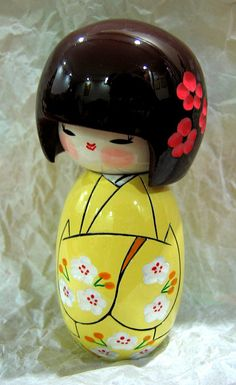 Kokeshi doll <3 them. Have my own treasured collection.